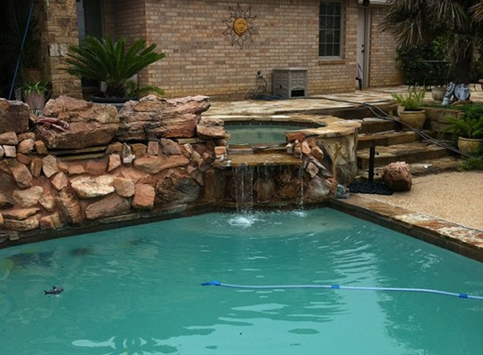 Natural-style pool with hot tub