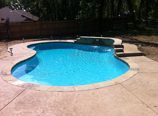 Modest pool with relaxing water spouts